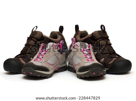 two pairs of trekking shoes. For father and child  - stock photo