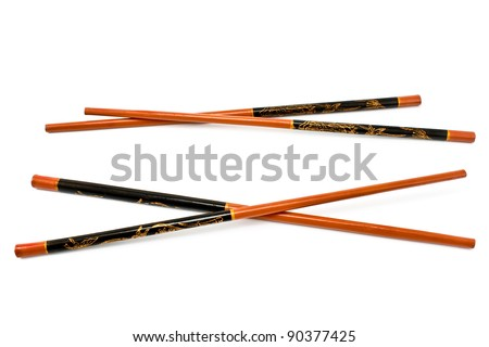 Two pairs of wooden chopsticks isolated on white - stock photo