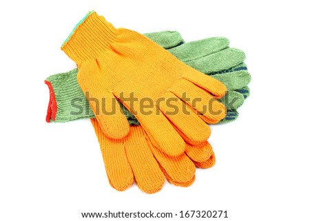 Two pairs of work gloves isolated on white background.