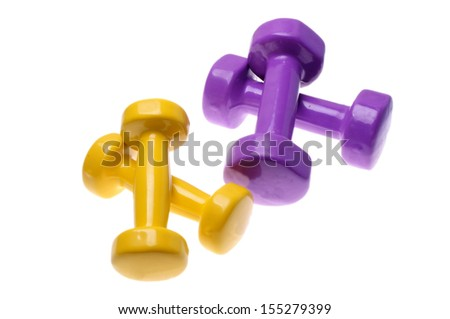 Two Pairs of yellow and purple dumbbells Isolated on white background  - stock photo