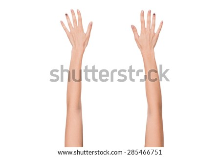 Two palms in the air demonstrating attention to individual. Brunette with hands up posing in photostudio. - stock photo