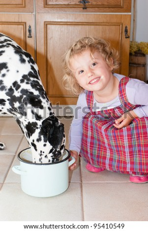 Two pals playing on the floor together. - stock photo