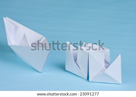 two paper boats