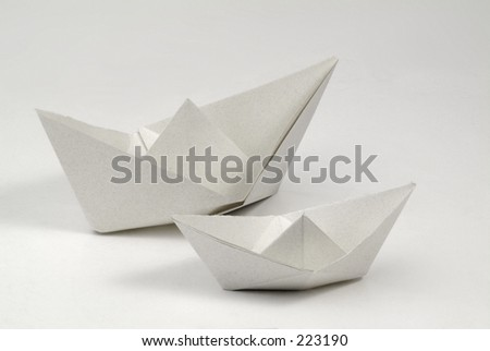 Two paper boats made from recycled paper