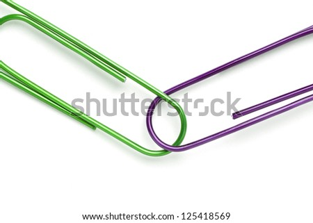 Two paper clips on white background