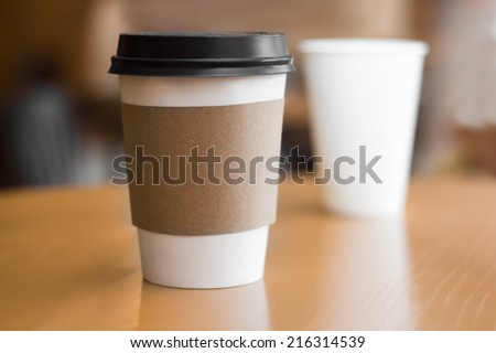 Two paper coffee cups - stock photo