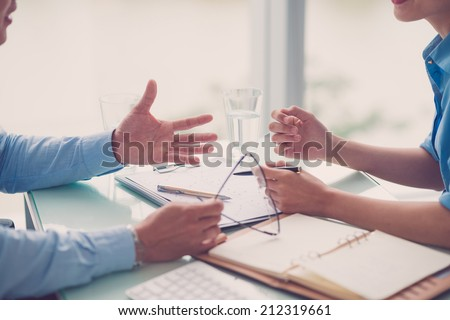 Two partners discussing business strategy in the office - stock photo