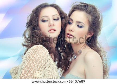 Two passionate women on abstract background - stock photo