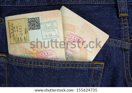 two passports in trousers pocket  - stock photo