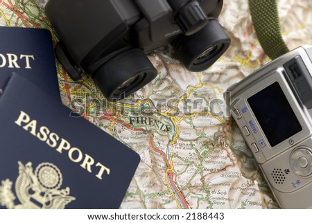 Two passports ready for the next vacation. The camera and binoculars are ready. - stock photo