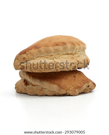 Two pastry stuffed with soft cheese on a white background - stock photo