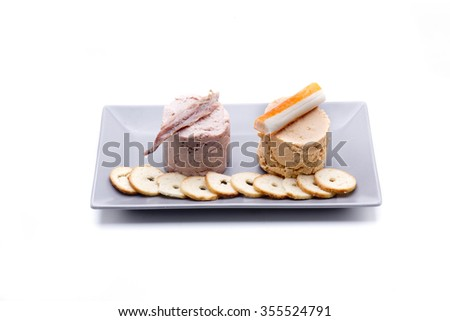 two pates, one seafood and anchovies, another cheese called Almogrote - stock photo