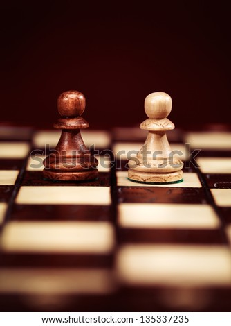 Two pawns chess pieces on a chessboard, concept - stock photo