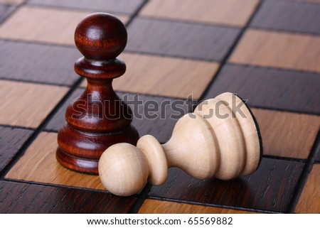 Two pawns on a chess board. Shallow depth of field - stock photo