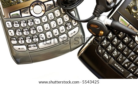 Two PDA devices isolated over white with copy space - stock photo