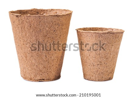 Two peat pots isolated on white background - stock photo