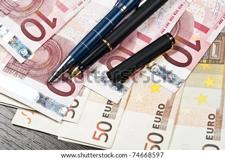 Two pen on euro banknotes