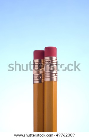 Two pencil eraser on a blue background