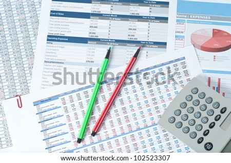 two pencils and calculator over financial documents