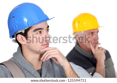 Two pensive construction workers. - stock photo