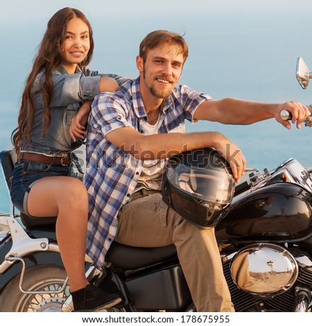 Two people and bike - fashion woman and man. Adventure and vacations concept - stock photo
