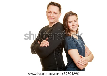 Two people as fitness couple smiling and leaning on each other