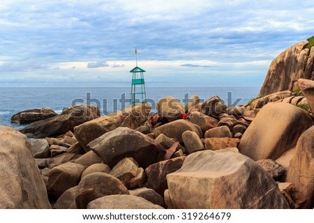 Two people climb on big rocks. Khanh Hoa, VietNam - June 16 2013: The group of people were climping on big rocks, Khanh Hoa, VietNam  - stock photo