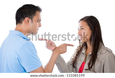 Two people, couple pointing fingers at each other, blaming each other for problem, isolated on white background - stock photo