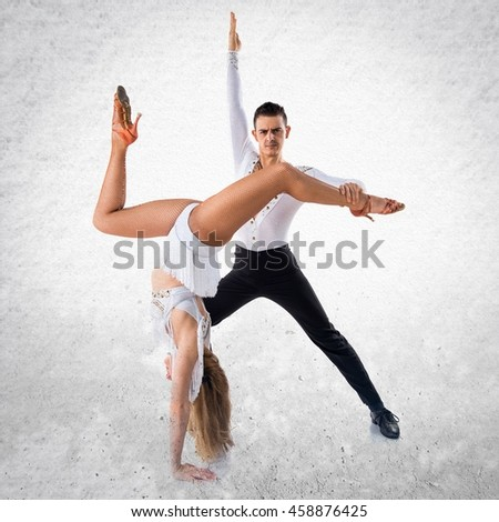 Two people dancing over textured background