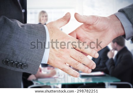 Two people going to shake their hands against businesswoman reporting to sales in a seminar - stock photo