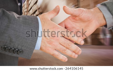 Two people going to shake their hands against worker with fork pallet truck stacker in warehouse - stock photo