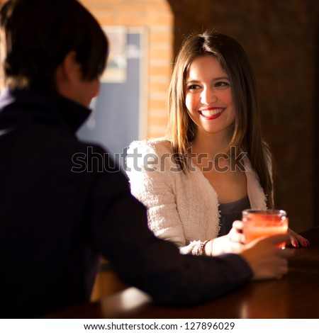 Two people having a drink in a pub - stock photo