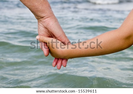 Two people hold hands and    go to sea