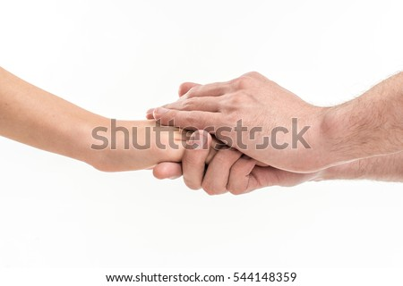 Two people holding hands for comfort on white