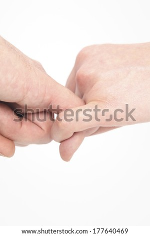 Two people holding the fingers - stock photo