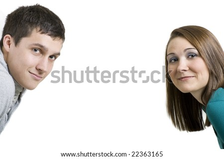 Two people looking into the portrait. - stock photo