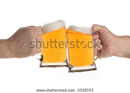 Two people making a toast with beer mugs - stock photo