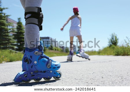 two people on the street in the summer - stock photo