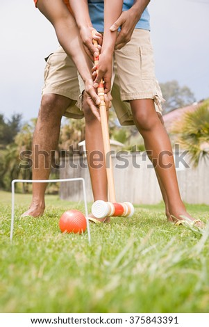 Two people playing croquet - stock photo