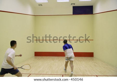 Two people playing squash - stock photo