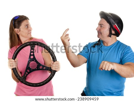 two people, pretending to drive a car and a motorcycle - stock photo