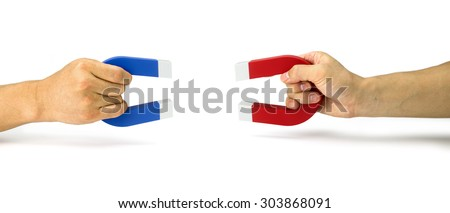 Two people pull holding magnets - stock photo