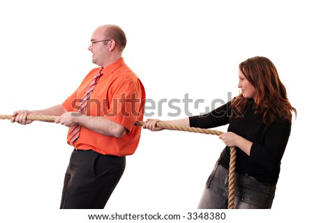 Two people pulling on a rope isolated on a white background. - stock photo