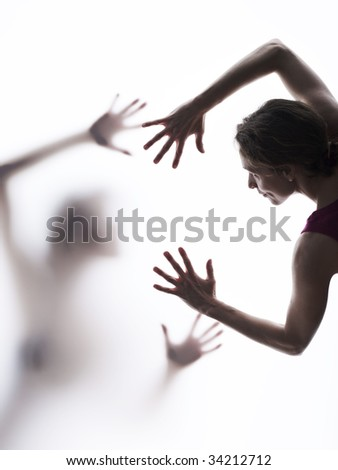 Two people reaching out to each other - stock photo