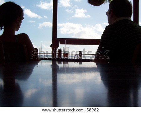 Two People Relaxing at a Beachside Bar