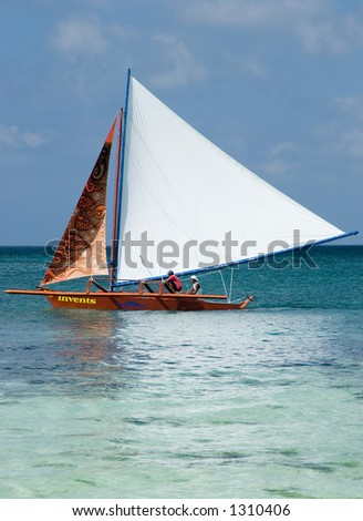 Two people sailing