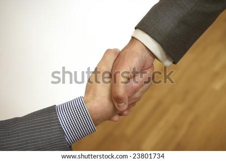Two people shake hands.