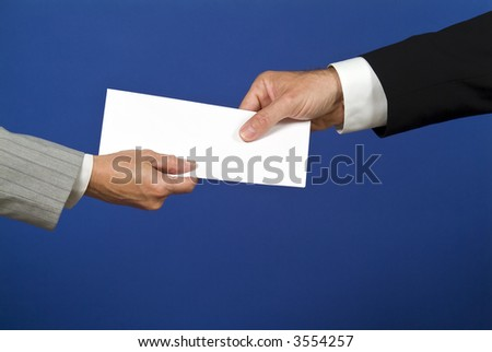 Two people shaking hands and exchanging a white envelope with available copy space for adding text. - stock photo