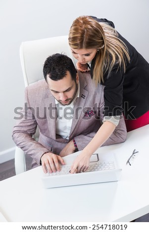 Two people sharing computer knowledge. Learning concept. - stock photo