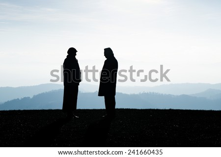 Two people talking about the future and making agreement. Landscape in the background - stock photo